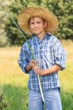 Teenage fisherman with rod at straw hat Royalty Free Stock Photos