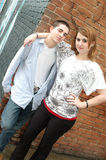 Teenage Friends. The relationship workings of a male and female teenage friend. Girl puts her arm around the boy to express that they get along stock image