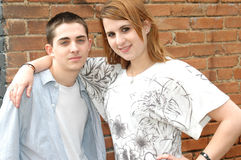 Teenage Friends. The relationship workings of a male and female teenage friend. Girl puts her arm around the boy to express that they get along stock images