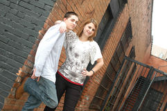 Teenage Friends. The relationship workings of a male and female teenage friend. Girl puts her arm around the boy to express that they get along royalty free stock photo