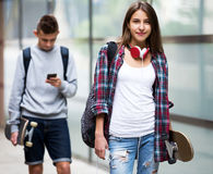 Teenage friends carrying skateboards in the city Royalty Free Stock Photo