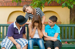 Teenage friends consoling and supporting friend Royalty Free Stock Photo
