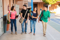 Teenage friends in a hallway Stock Images