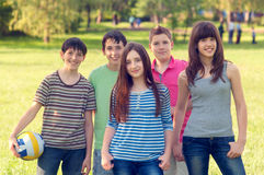 Teenage friends having fun in the park Royalty Free Stock Photo
