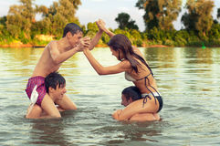 Teenage friends having fun in the river Royalty Free Stock Images
