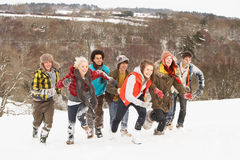 Teenage Friends Having Fun In Snow Stock Photography
