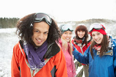 Teenage Friends Having Fun In Snowy Landscape Royalty Free Stock Photo