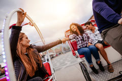 Teenage friends having fun on tricycles Royalty Free Stock Images