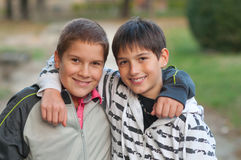 Teenage friends hugging each other Stock Images