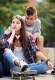 Teenage friends making things up after quarrel Stock Image