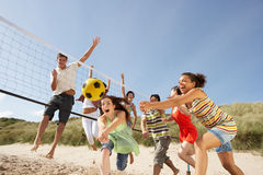 Teenage Friends Playing Volleyball On Beach Stock Images
