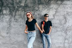 Teenage friends in same clothes stock photography