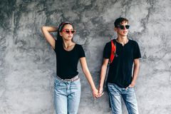 Teenage friends in same clothes royalty free stock photo