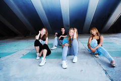 Teenage friends sitting Royalty Free Stock Image