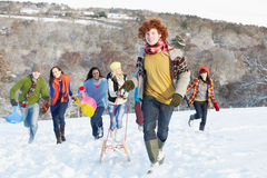 Teenage Friends Sledging In Snowy Landscape Stock Photos