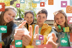 Teenage friends or students showing thumbs up Royalty Free Stock Photo
