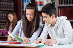 Teenage Friends Studying Together At Desk Royalty Free Stock Photography