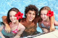 Teenage friends in a swimming pool Stock Photo