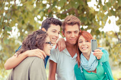 Teenage Friends Taking Self Portraits Stock Images