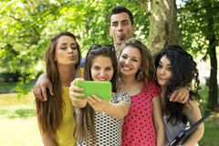 Teenage Friends Taking Selfie at Park. Smiling and making funy faces Royalty Free Stock Photography