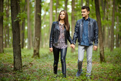 Teenage friends. Teenagers boy and girl on a date, taking a walk through the forest Royalty Free Stock Images