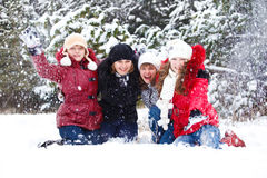Teenage  friends throwing snow Royalty Free Stock Photos