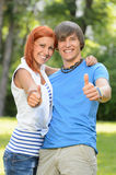 Teenage friends thumb up sunny park Royalty Free Stock Image