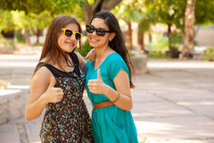 Teenage friends with thumbs up Stock Image