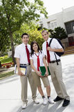 Teenage Friends In Uniform Royalty Free Stock Image