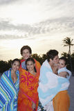 Teenage Friends Wrapped In Towels At Beach. Group of teenage friends wrapped in towels at beach Royalty Free Stock Photos