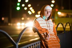 Teenage gang member at night Stock Images