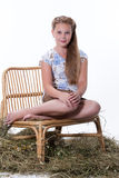Teenage Girl. And of hay on isolated background royalty free stock photos