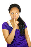 Teenage girl. Isolated portrait of black teenage girl gesturing for quiet royalty free stock photography