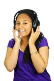 Teenage girl. Isolated portrait of black teenage girl listening to headphones royalty free stock photos