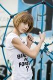 Teenage girl. On the playground royalty free stock image
