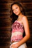 Teenage Girl. Beautiful african american teenage girl standing against barn wood background stock image