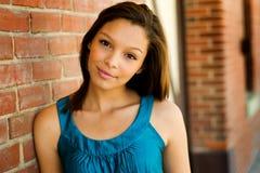 Teenage Girl. Beautiful african american teenage girl leaning against brick wall royalty free stock photo