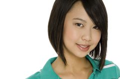 Teenage Girl. An attractive asian teenage female in green top on white background royalty free stock photos