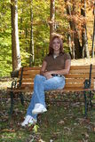 Teenage girl. Sitting by the pond Royalty Free Stock Photography