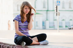 Happy teen girl on city street Stock Photos