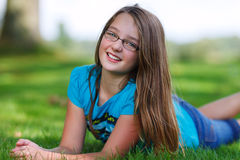 Teenage girl. Smiling outdoor in grass Royalty Free Stock Images