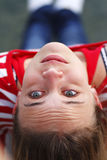 Teenage Girl. In casual jeans and shirt having fun taken upside down Royalty Free Stock Photo