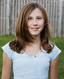 Teenage Girl. Portrait of Teenage Girl with a pretty smile, looking into camera stock photo