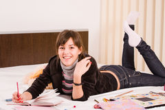 Teenage girl. Funny teenage girl writing in her diary Royalty Free Stock Photos
