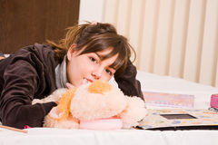 Teenage girl. Funny teenage girl playing with her fluffy toy Stock Image
