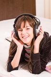 Teenage girl. Smiling with professional earphones Royalty Free Stock Images