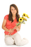Teenage girl. Beautiful teenage girl holding bunch of sunflowers isolated on white background Stock Photo