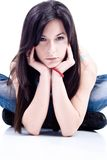 Teenage girl. Young teenage girl leaned on elbows royalty free stock photography