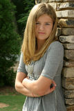 Teenage girl. Wearing a grey shirt with arms crossed Royalty Free Stock Photography