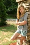 Teenage girl. Wearing a gray shirt and shorts Royalty Free Stock Photography